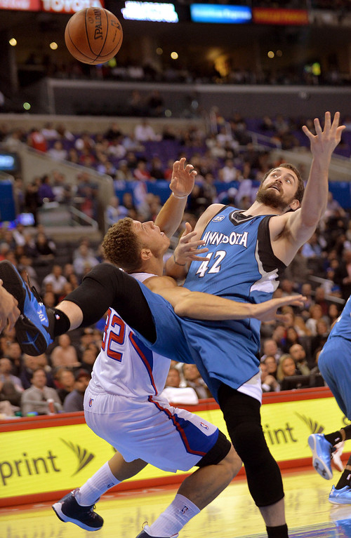 . Los Angeles Clippers\' Blake Griffin and Kevin Love of the Minnesota Timberwolves\' battle under the hoop duirng the first half Monday, Nov. 11, 2013, in Los Angeles.(Andy Holzman/Los Angeles Daily News)