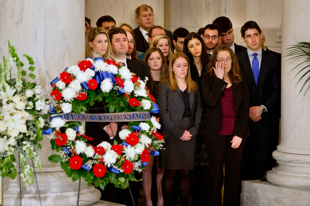 . Law clerks and Supreme Court staff watch a private ceremony in the Great Hall of the Supreme Court in Washington, Friday, Feb. 19, 2016, where late Supreme Court Justice Antonin Scalia lies in repose. (AP Photo/Jacquelyn Martin, Pool)