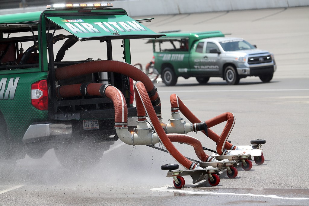. Air Titans dry the track during a delay in the NASCAR Sprint Cup series auto race at Michigan International Speedway, Sunday, June 14, 2015, in Brooklyn, Mich. (AP Photo/Dave Frechette)