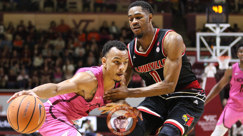 Justin Robinson attempts to dribble the ball to the Louisville basket. (Mark Umansky/TheKeyPlay.com)