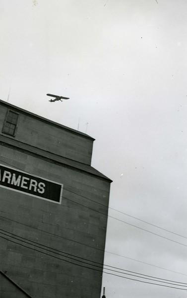 JA087.  Plane over Farmers Elevator Co. – Arthur - 1940‡ .jpg
