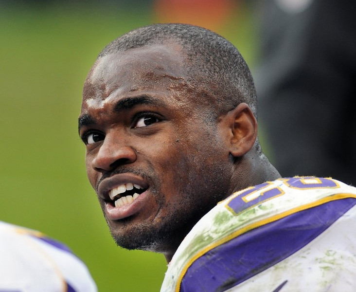 """. <p><b> Vikings running back Adrian Peterson showed how he truly feels about his blockers by giving each of his offensive linemen a � </b> <p> A. Snowmobile <p> B. Brand new car <p> C. Swift kick in the ass <p><b><a href=\'http://www.cbssports.com/nfl/eye-on-football/24147863/vikings-rb-adrian-peterson-rewards-oline-for-2012-with-snowmobiles\' target=\""""_blank\"""">HUH?</a></b> <p>     (Pioneer Press: Chris Polydoroff)"""