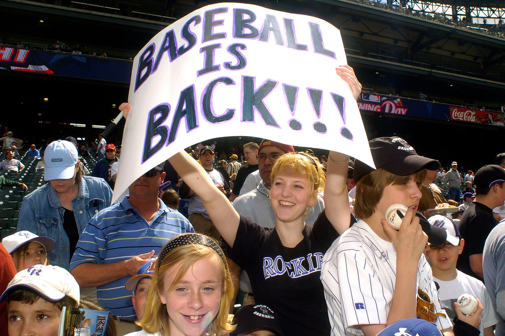 . Colorado Rockies fan Gillian Rhodes, 16, of Evergreen celebrates the Opening day at Coors Field on Monday, April 2, 2007. (Hyoung Chang / The Denver Post)