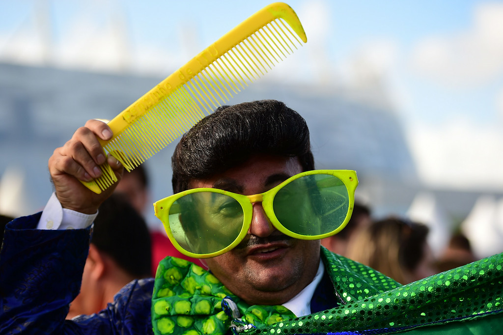 . A fan arrives to attend the round of 16 football match between Costa Rica and Greece at Pernambuco Arena in Recife during the 2014 FIFA World Cup on June 29, 2014.   RONALDO SCHEMIDT/AFP/Getty Images