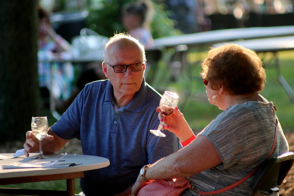 . Ed and Mickie Zalar of Broadview Heights enjoy some wine in the shade at the 2016 Annual Vintage Ohio event at Lake Metroparks� Farmpark in Kirtland. Vintage Ohio marks its 24th year in 2018 and organizers say a record number of vendors, along with numerous wineries, breweries and food purveyors, will be on hand during the Aug. 3-4 event. For more information, visit visitvintageohio.com. (News-Herald file)