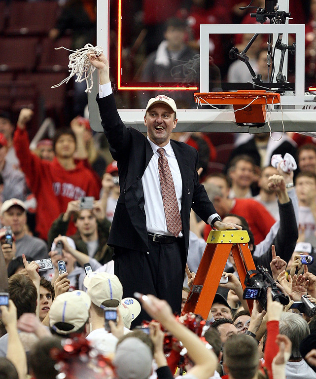 . Ohio State coach Thad Matta holds the net after a basketball game against Wisconsin Sunday, Feb 25, 2007, in Columbus, Ohio. Ohio State won 49-48. (AP Photo)