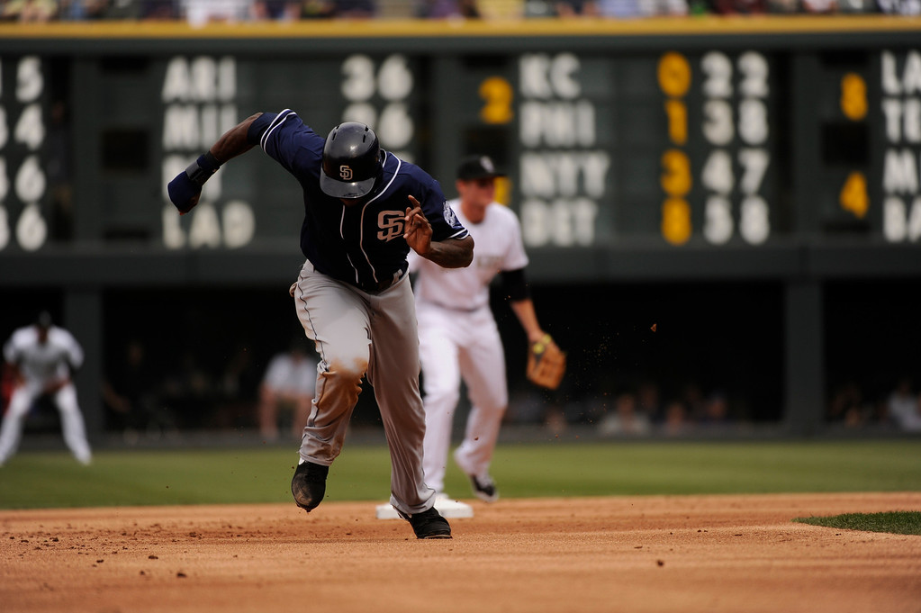 . Cameron Maybin (24) of the San Diego Padres advances to third on a grounder to second base in the second inning.  (Photo by Karl Gehring/The Denver Post)