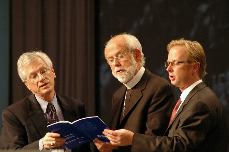 Secretary Swartling, Bishop Hanson and Dr. Michael Trice singing after the adoption of the Full Communion agreement with the UMC.