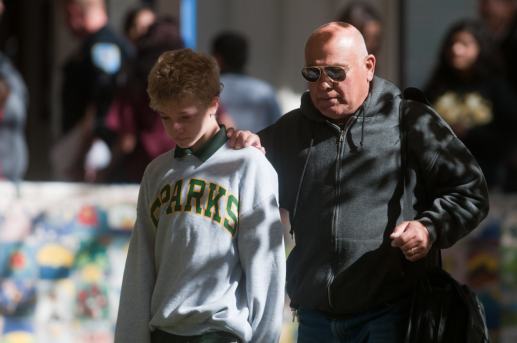 . A parent escorts his child from Agnes Risley Elementary school following a shooting at nearby Sparks Middle School October 21, 2013 in Sparks, Nevada. A staff member was killed and two students were injured after a student opened fire at the Nevada middle school. The suspected gunman was also killed. Students from the middle school were evacuated and held for parents at the elementary school.  (Photo by David Calvert/Getty Images)