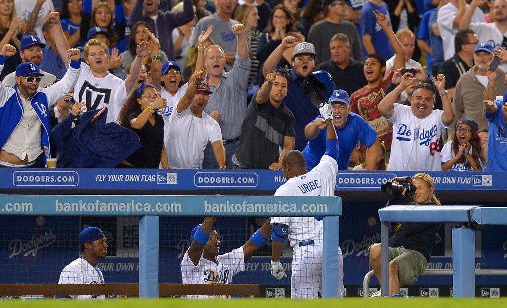 . Juan Uribe is cheered by fans after hitting his thrid homerun against the Arizona Diamondbacks Monday, September 9, 2013.(Andy Holzman/Los Angeles Daily News)