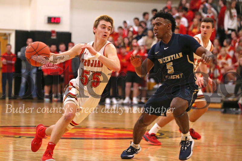 North Catholic's Isaac DeGregori drives past Vincentian Academy's Alex Griggs in Saturday's 77-67 Trojan win. Seb Foltz/Butler Eagle