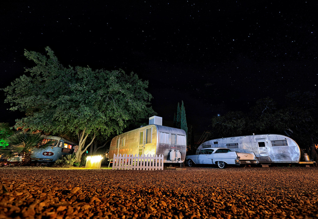 . Stars shine above a 1950 Hughes Spartan trailer, right, a 1950 Boles Aero trailer, center, and a 1947 Airporter bus at the Shady Dell Trailer Court, late Wednesday, April 26, 2017, in Bisbee, Ariz. Vintage aluminum travel trailers, a yacht and a Hawaiian-themed bus are used as guests rooms at the trailer lodge. Views of Southern Arizona\'s star-filled sky are unencumbered by artificial light. (AP Photo/Matt York)