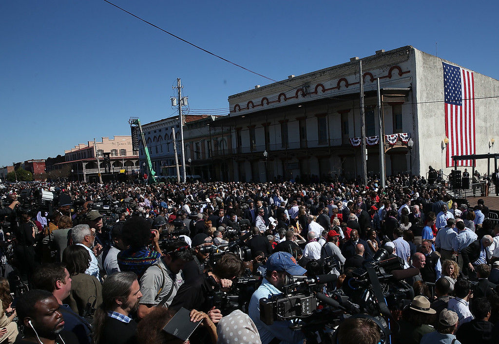 . A crowd looks on as U.S. president Barack Obama speaks in front of the Edmund Pettus Bridge on March 7, 2015 in Selma, Alabama. Selma is commemorating the 50th anniversary of the famed civil rights march from Selma to Montgomery that resulted in a violent confrontation with Selma police and State Troopers on the Edmund Pettus Bridge on March 7, 1965.  (Photo by Justin Sullivan/Getty Images)