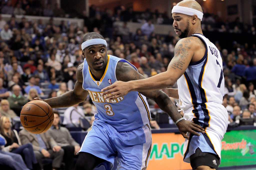 . Memphis Grizzlies\' Jerryd Bayless (7) defends Denver Nuggets\' Ty Lawson (3) during the first half of an NBA basketball game in Memphis, Tenn., Saturday, Dec. 28, 2013. (AP Photo/Danny Johnston)