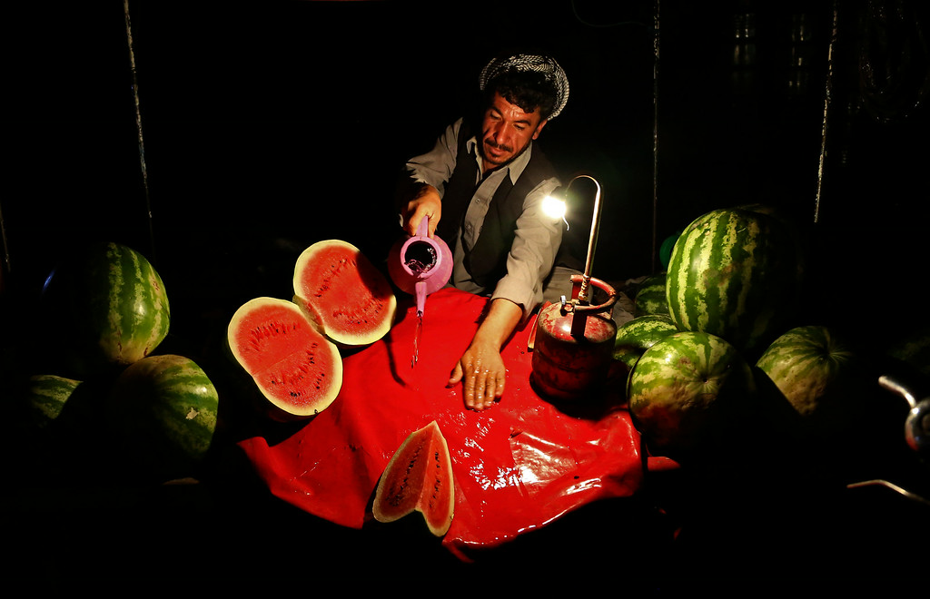 . An Afghan street vendor who sells watermelons, waits for customers ahead of the Islamic holy month of Ramadan in Kabul, Afghanistan, Saturday, June 28, 2014. Muslims throughout the world are preparing for the holy month of Ramadan, when the observant fast from dawn till dusk. (AP Photo/Rahmat Gul)