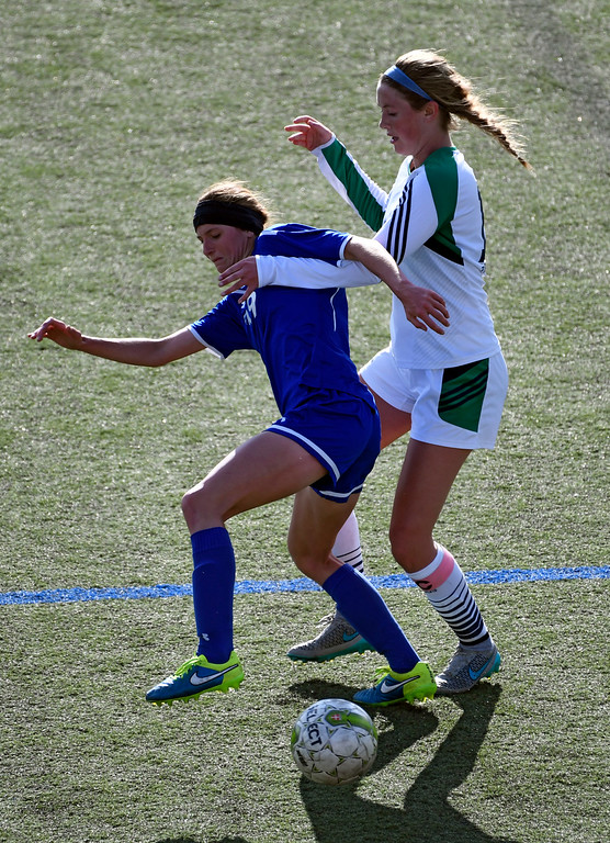 . HIGHLANDS RANCH, CO - MAY 18: ThunderRidge Erin Speer (12) and Broomfield Hailey Stodden (19) battle for the ball during the second half in girls quarterfinals May 18, 2016 at Shea Stadium. Broomfield defeated ThunderRidge 2-0. (Photo By John Leyba/The Denver Post)