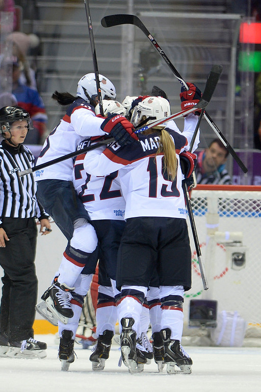 . Team U.S.A. celebrates a 1-0 goal by Meghan Duggan (10) against Canada during the second period of the women\'s gold medal ice hockey game. Sochi 2014 Winter Olympics on Thursday, February 20, 2014 at Bolshoy Ice Arena. (Photo by AAron Ontiveroz/ The Denver Post)