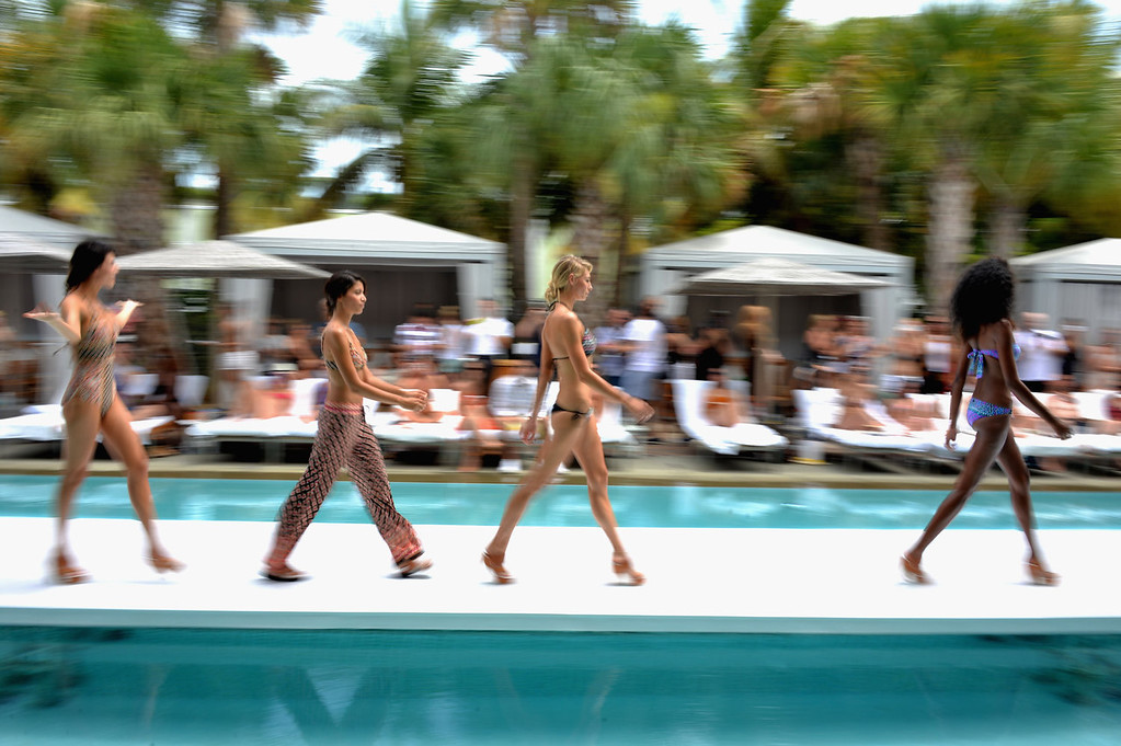. Models walk the runway at the Nanette Lepore Swim show during Mercedes-Benz Fashion Week Swim 2014 at the Raleigh on July 21, 2013 in Miami Beach, Florida.  (Photo by Andrew H. Walker/Getty Images for Mercedes-Benz Fashion Week Swim 2014)