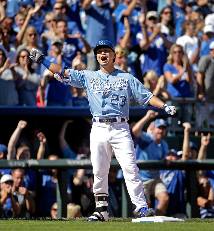 . Kansas City Royals\' Norichika Aoki celebrates after hitting a two-run triple during the fourth inning of a baseball game against the Detroit Tigers, Sunday, Sept. 21, 2014, in Kansas City, Mo. (AP Photo/Charlie Riedel)