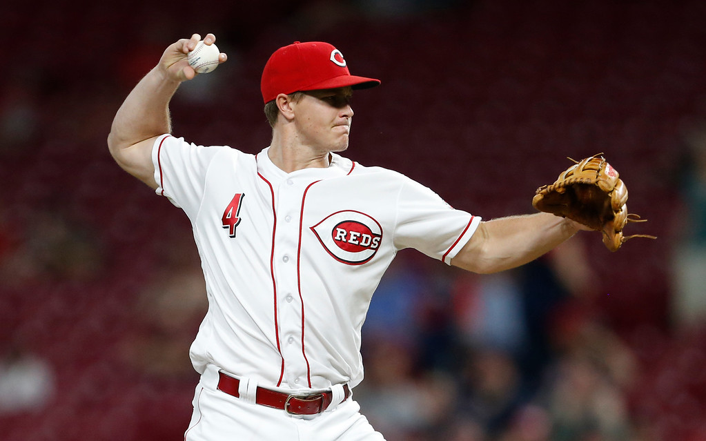 . Cincinnati Reds left fielder Brandon Dixon throws in relief against the Cleveland Indians during the ninth inning of a baseball game, Monday, Aug. 13, 2018, in Cincinnati. The Indians won 10-3. (AP Photo/Gary Landers)