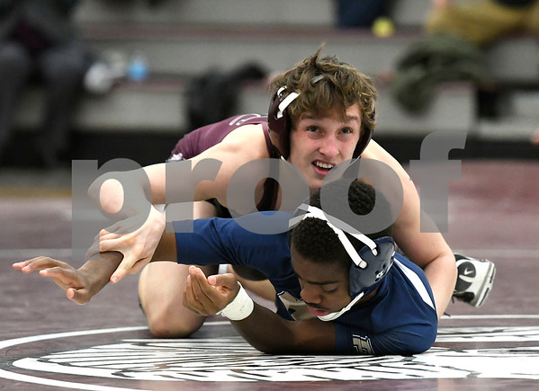 1/31/2018 Mike Orazzi | Staff Bristol Central's Chris Trelli and Platt's Isaiah Ross during Wednesday night's match at BC.