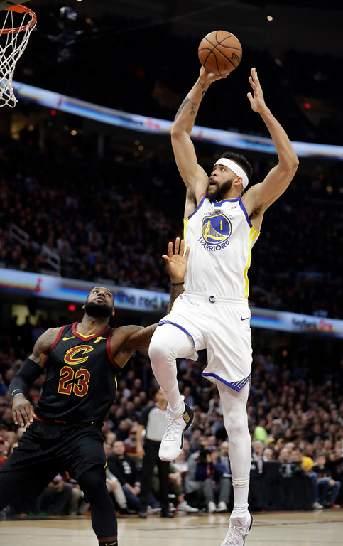 . Golden State Warriors\' JaVale McGee goes to the basket against Cleveland Cavaliers\' LeBron James in the first half of Game 3 of basketball\'s NBA Finals, Wednesday, June 6, 2018, in Cleveland. (AP Photo/Tony Dejak)