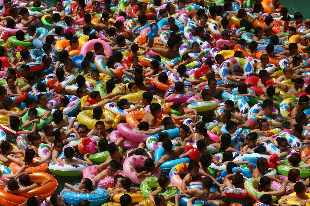 . This picture taken on July 25, 2014 shows people cooling off in a water park in Suining, southwest China\'s Sichuan province. Meteorological departments issued an orange alert for high temperature as a heat wave embraces Sichuan province, with temperature of most area topped 37 , local media reported. CHINA OUT   AFP PHOTOSTR/AFP/Getty Images