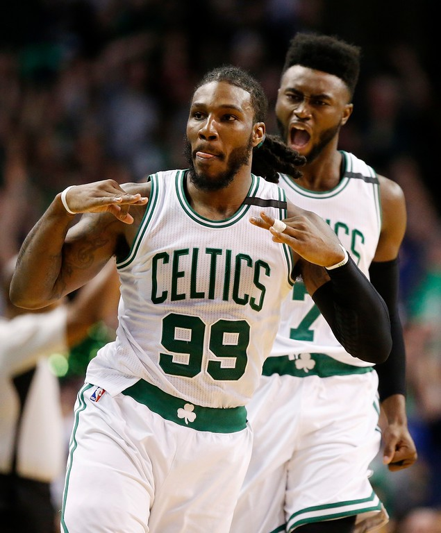 . Boston Celtics\' Jae Crowder (99) celebrates his three-pointer in front of teammate Jaylen Brown (7) during the fourth quarter of a second-round NBA playoff series basketball game against the Washington Wizards, Sunday, April, 30, 2017, in Boston. The Celtics won 123-111. (AP Photo/Michael Dwyer)
