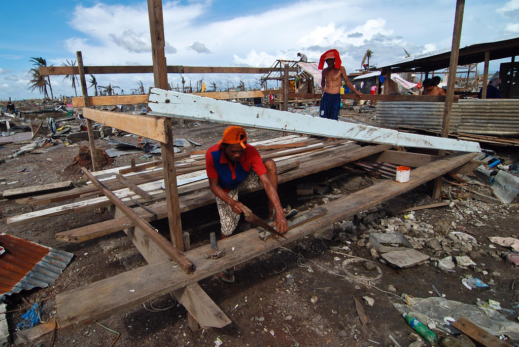 . Survivors try to rebuild their shanty following the recent super typhoon on November 21, 2013 in Tacloban, Leyte, Philippines.  (Photo by Dondi Tawatao/Getty Images)