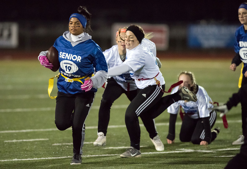 11/20/18  Wesley Bunnell   Staff  Plainville Seniors vs Juniors in powder puff football on Tuesday night at Plainville High School. Sydni Spencer carries the ball for the seniors.