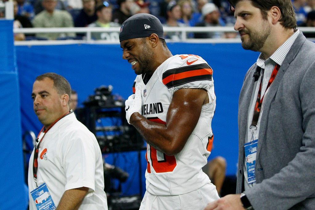 . Cleveland Browns wide receiver C.J. Board, center, walks off the field after an injury during the first half of an NFL football preseason game against the Detroit Lions, Thursday, Aug. 30, 2018, in Detroit. (AP Photo/Duane Burleson)