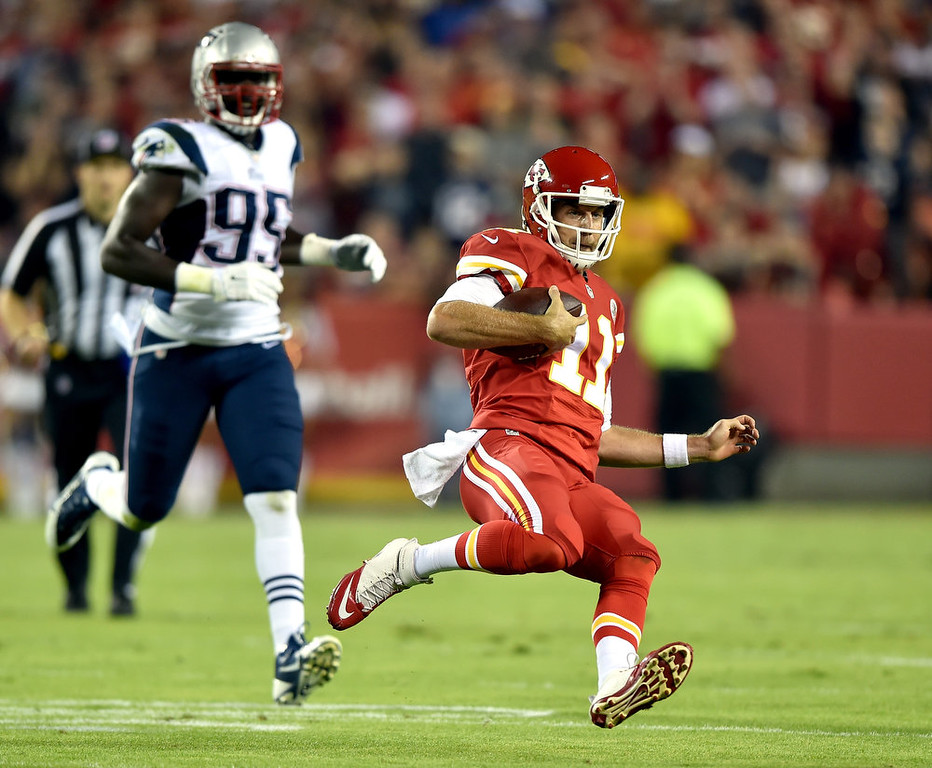 . Alex Smith #11 of the Kansas City Chiefs runs the ball against the New England Patriots during the first quarter at Arrowhead Stadium on September 29, 2014 in Kansas City, Missouri.  (Photo by Peter Aiken/Getty Images)