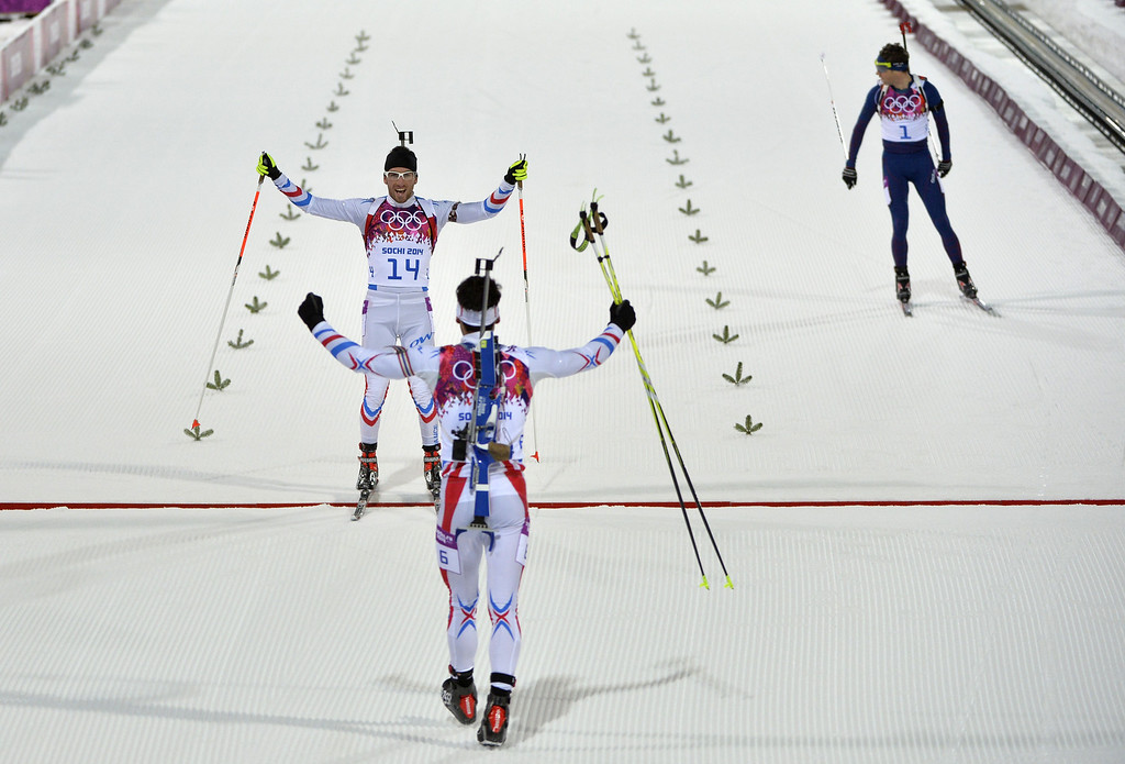 . France\'s Martin Fourcade (6) celebrates winning gold along with fellow Frenchman Jean Guillaume Beatrix  (14) who won bronze in the Men\'s Biathlon 12,5 km Pursuit at the Laura Cross-Country Ski and Biathlon Center during the Sochi Winter Olympics on February 10, 2014 in Rosa Khutor near Sochi.   ODD ANDERSEN/AFP/Getty Images