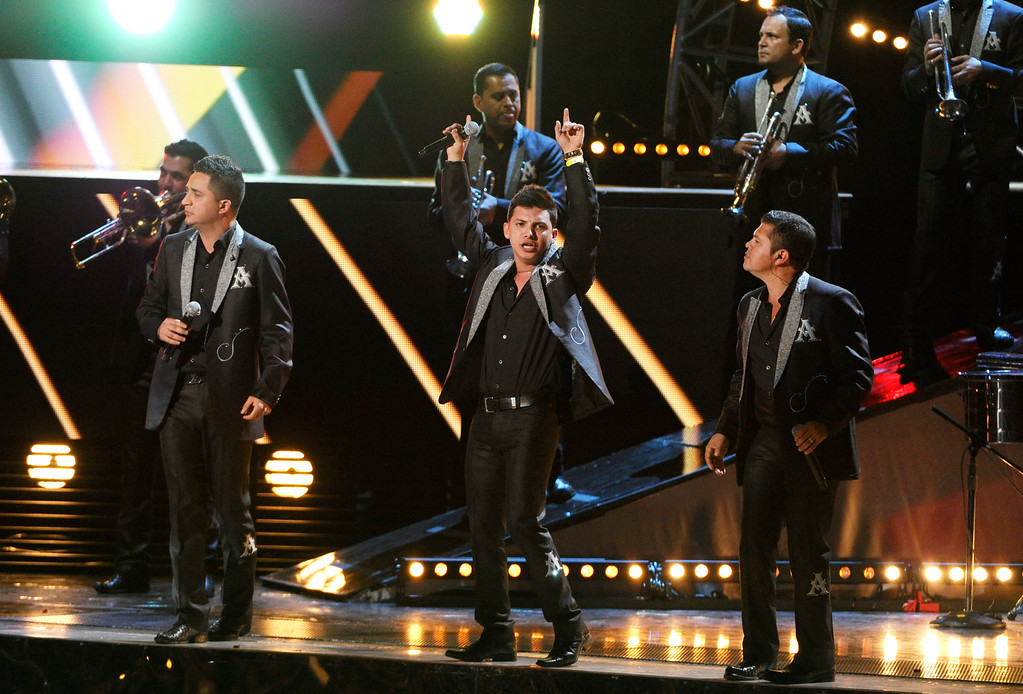 . Members of La Arrolladora Banda El Limon perform at the 15th annual Latin Grammy Awards at the MGM Grand Garden Arena on Thursday, Nov. 20, 2014, in Las Vegas. (Photo by Chris Pizzello/Invision/AP)