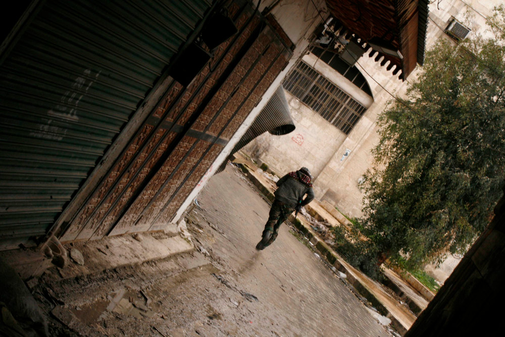 Description of . A Free Syrian Army fighter runs to avoid a sniper in Bab al-Nasr neighborhood in Aleppo February 11, 2013. Picture taken February 11, 2013. REUTERS/Zaid Rev