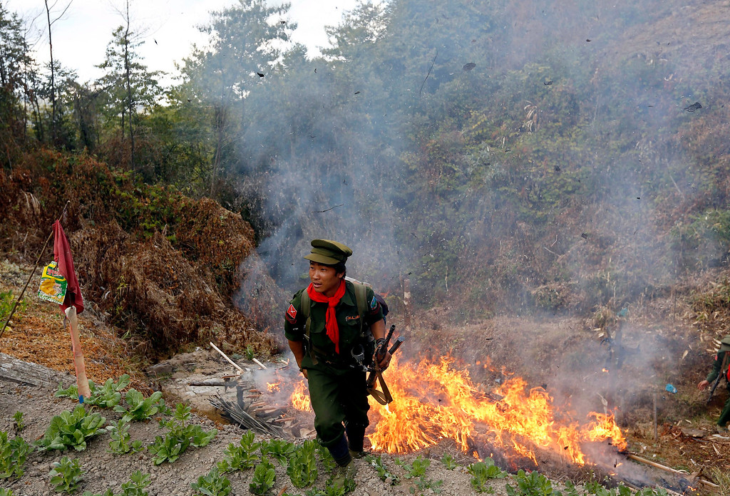 . A soldier from Ta-ang National Liberation Army (TNLA), one of the ethnic rebel groups, walks out from a burning poppy field in Loi Mel Main village, Man Tone Township, Northern Shan State, Myanmar. Myanmar\'s opium production in 2013 was expected to reach 870 tons, a 26-per-cent increase year-on-year, for a 13-per-cent increase in cultivated area, the United Nations said. Last year, Myanmar produced an estimated 690 tons of opium, compared with 41 tons in Laos and 3 tons in Thailand, the three significant producers in South-East Asia. Myanmar was the world\'s largest source of opium and its derivative heroin in the early 1990s, but is now ranked second after Afghanistan. Myanmar\'s northern Shan State, home to several insurgencies including the Shan State Army and United Wa State Army, accounted for 92 per cent of opium poppy cultivation this year, with the remainder located in neighbouring Kachin State, where government troops and the Kachin Independence Army have been fighting since 2011, the report sai EPA/NYEIN CHAN NAING