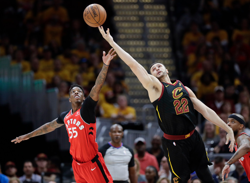 . Cleveland Cavaliers\' Larry Nance Jr. (22) and Toronto Raptors\' Delon Wright (55) react for the ball in the second half of Game 4 of an NBA basketball second-round playoff series, Monday, May 7, 2018, in Cleveland. The Cavaliers won 128-93. (AP Photo/Tony Dejak)