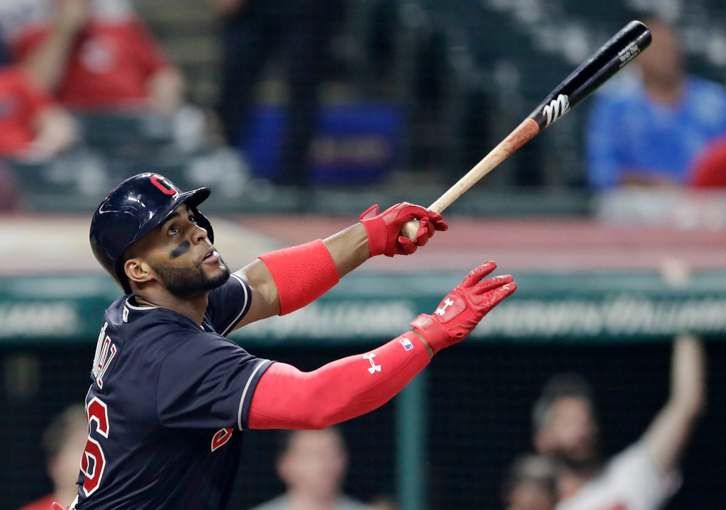 . Cleveland Indians\' Yandy Diaz watches his ball after hitting a one-run triple in the seventh inning of a baseball game against the Kansas City Royals, Tuesday, Sept. 4, 2018, in Cleveland. (AP Photo/Tony Dejak)