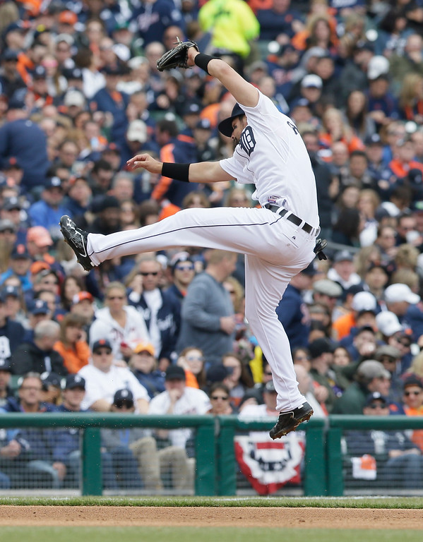 . Detroit Tigers third baseman Nick Castellanos leaps but is unable to play the single by Minnesota Twins designated hitter Kennys Vargas during the fifth inning of an opening day baseball game in Detroit, Monday, April 6, 2015. (AP Photo/Carlos Osorio)