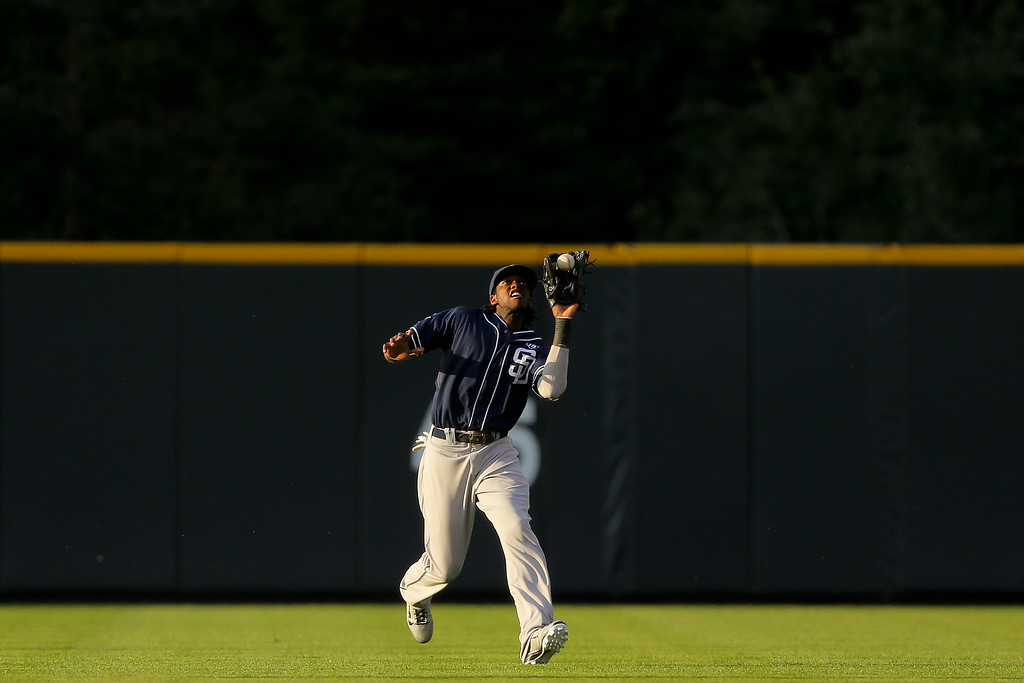 . DENVER, CO - SEPTEMBER 6:  Center fielder Cameron Maybin #24 of the San Diego Padres makes a catch on the run for the first out of the first inning against the Colorado Rockies at Coors Field on September 6, 2014 in Denver, Colorado. (Photo by Justin Edmonds/Getty Images)