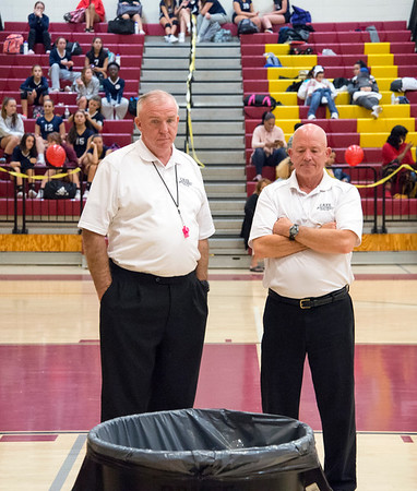 10/30/19 Wesley Bunnell | StaffrrVolleyball officials look on as a garbage pail catches rain water which had been dripping onto the New Britain High School gym floor on Wednesday night. The leak caused the postponement of the girls volleyball game vs Rocky Hill during the second set with the game to be continued tomorrow at Rocky Hill High School at 4p.m. as more rain is in the forecast.