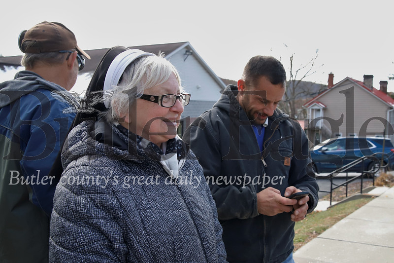 Sister Patricia Myers and a handful of former St. Matthias Catholic Church members came out to watch their former parish being torn down Thursday. Seb Foltz/Butler Eagle