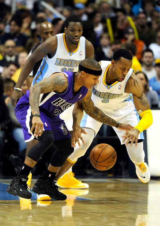 . DENVER, CO. - MARCH 22: Andre Iguodala (9) of the Denver Nuggets went for a steal on Isaiah Thomas (22) of the Sacramento Kings in the second half. The Denver Nuggets defeated the Sacramento Kings 101-95 Saturday night, March 23, 2013 at the Pepsi Center. The Nuggets extended its longest winning streak since joining the NBA to 15 games with the win over the Kings. (Photo By Karl Gehring/The Denver Post)