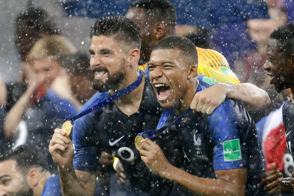 . France\'s Kylian Mbappe, right, and teammate Olivier Giroud celebrates after the final match between France and Croatia at the 2018 soccer World Cup in the Luzhniki Stadium in Moscow, Russia, Sunday, July 15, 2018. (AP Photo/Natacha Pisarenko)