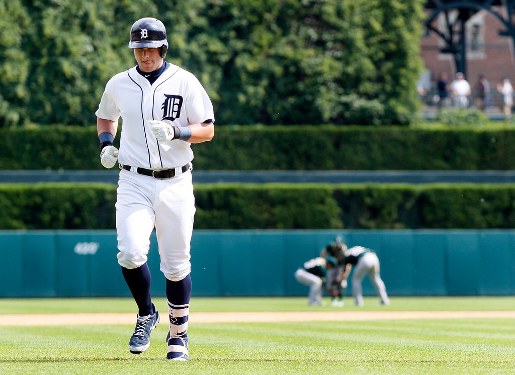 . Detroit Tigers\' James McCann heads for the dugout after flying out in the ninth inning to end a baseball game against the Oakland Athletics at Comerica Park Thursday, June 4, 2015, in Detroit. The Athletics defeated the Tigers 7-5. (AP Photo/Duane Burleson)