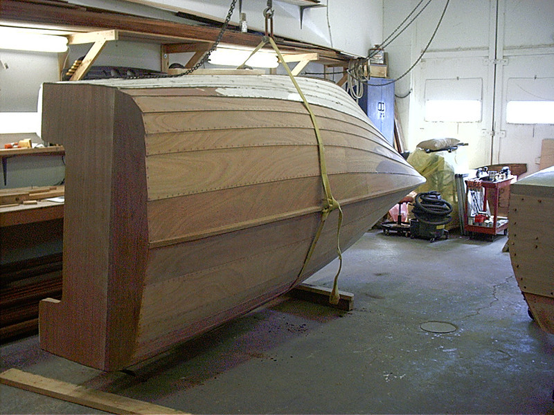 Turning the hull right side up.