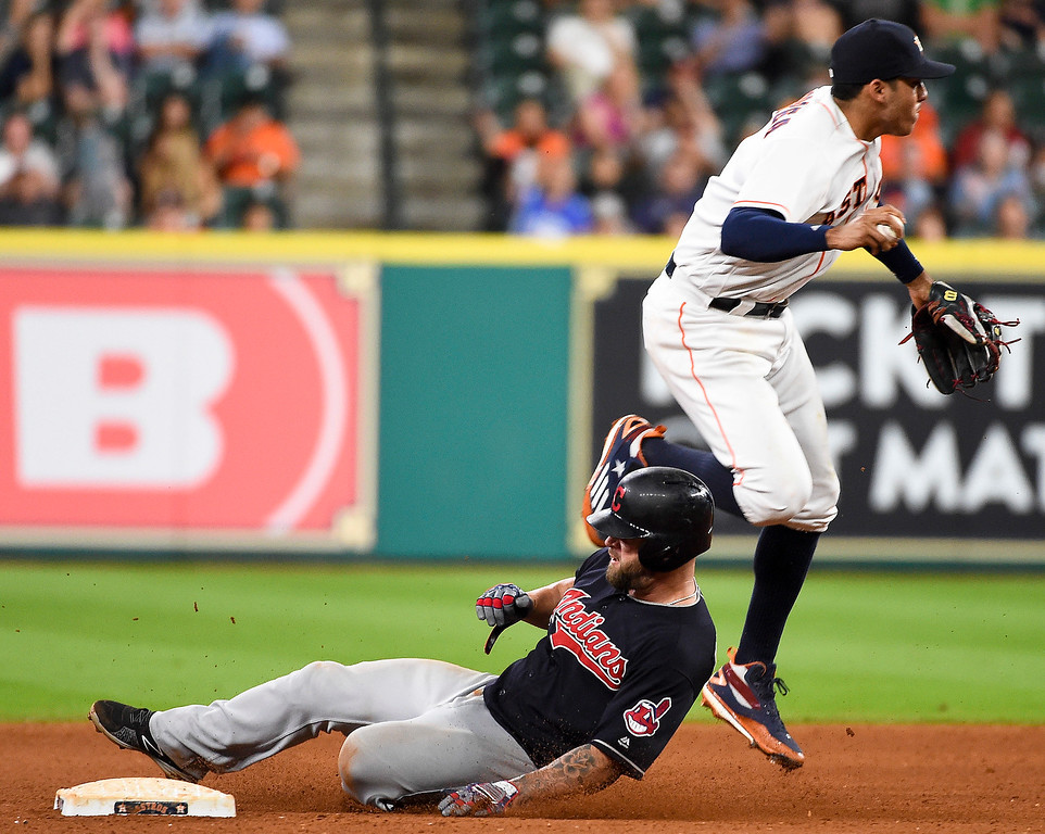 . Cleveland Indians\' Yan Gomes, left, breaks up the double play attempt of Houston Astros shortstop Carlos Correa in the seventh inning of a baseball game, Monday, May 9, 2016, in Houston. (AP Photo/Eric Christian Smith)
