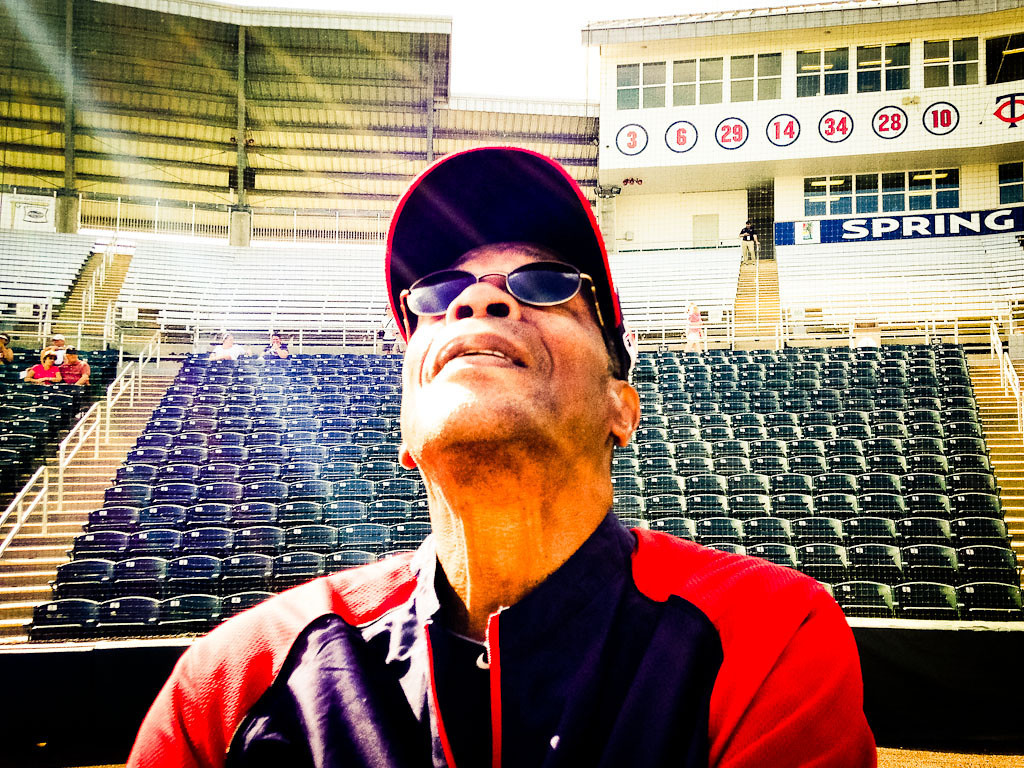 . Former Twins player and baseball Hall of Famer Rod Carew watches a pop fly soar during batting practice. Carew is an amateur photographer and said that back in the day he had a remote camera set up while playing first base. (Pioneer Press: Ben Garvin)