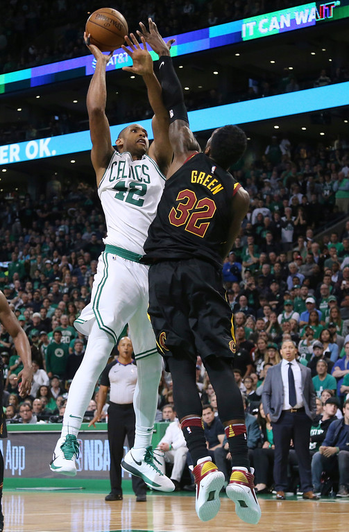. Boston Celtics forward Al Horford shoots against Cleveland Cavaliers forward Jeff Green (32) during the second half in Game 7 of the NBA basketball Eastern Conference finals, Sunday, May 27, 2018, in Boston. (AP Photo/Elise Amendola)