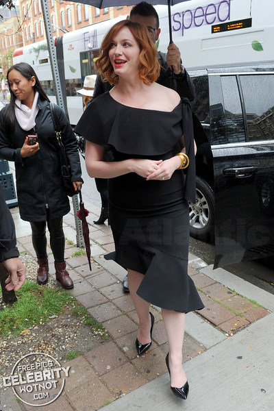 Christina Hendricks Fashions Off The Shoulder Black Dress and Bright Red Lipstick